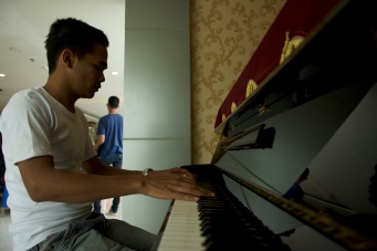 Doni playing piano